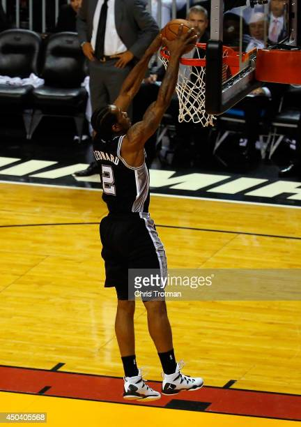 Kawhi Leonard of the San Antonio Spurs dunks against the Miami Heat during Game Three of the 2014 NBA Finals at American Airlines Arena on June 10...