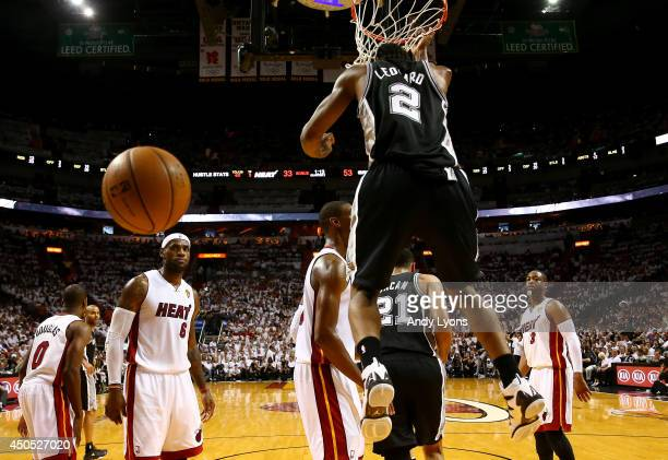 Kawhi Leonard of the San Antonio Spurs dunks against the Miami Heat during Game Four of the 2014 NBA Finals at American Airlines Arena on June 12...