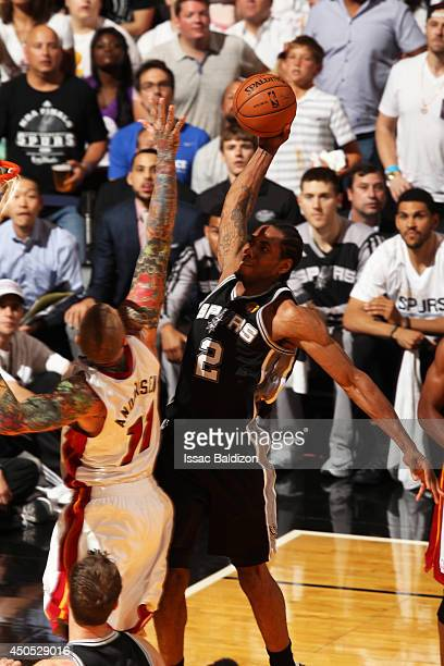 Kawhi Leonard of the San Antonio Spurs dunks against the Miami Heat during Game Four of the NBA Finals at the American Airlines Arena in Miami...