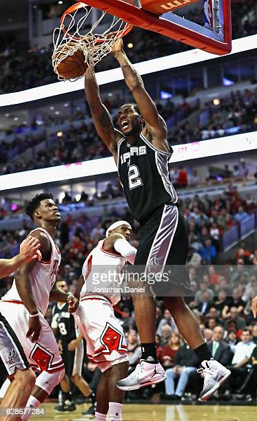 Kawhi Leonard of the San Antonio Spurs dunks over Jimmy Butler of the Chicago Bulls on his way to a gamehigh 24 points at the United Center on...