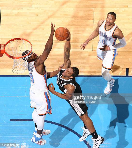 Kawhi Leonard of the San Antonio Spurs dunks over Serge Ibaka of the Oklahoma City Thunder in Game 6 of the Western Conference Finals during the 2014...