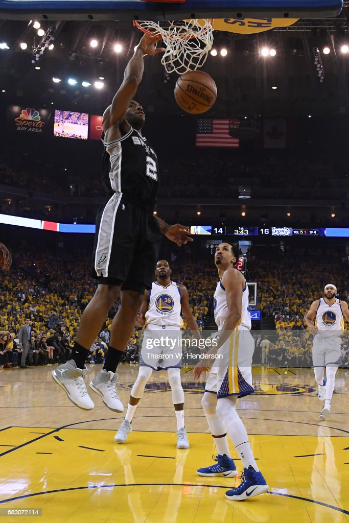 Kawhi Leonard #2 of the San Antonio Spurs dunks the ball against the Golden State Warriors during Game One of the NBA Western Conference Finals at ORACLE Arena on May 14, 2017 in Oakland, California.