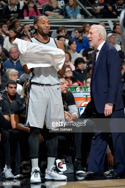 Kawhi Leonard of the San Antonio Spurs gets coached by head coach Gregg Popovich during the game against the Denver Nuggets on January 13 2018 at the...