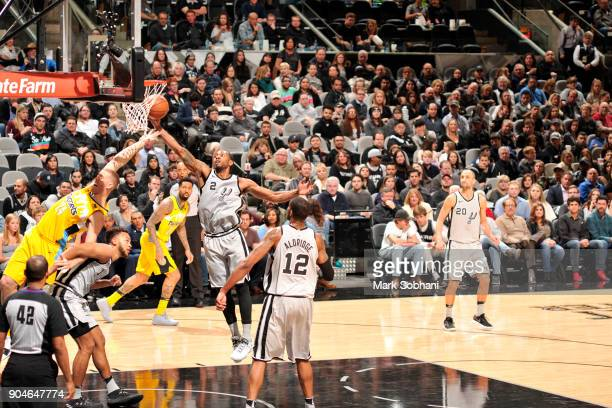 Kawhi Leonard of the San Antonio Spurs gets the rebound against the Denver Nuggets on January 13 2018 at the ATT Center in San Antonio Texas NOTE TO...
