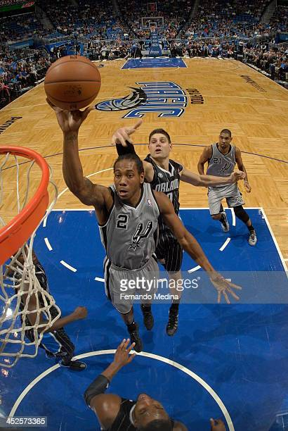 Kawhi Leonard of the San Antonio Spurs glides to the basket against the Orlando Magic during the game on November 29 2013 at Amway Center in Orlando...