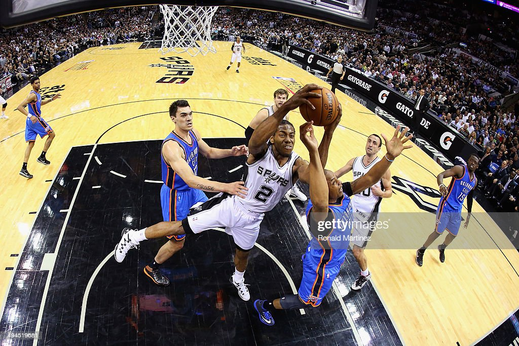 Kawhi Leonard #2 of the San Antonio Spurs goes for a rebound against Caron Butler #2 of the Oklahoma City Thunder in the second half during Game Five of the Western Conference Finals of the 2014 NBA Playoffs at AT&T Center on May 29, 2014 in San Antonio, Texas.