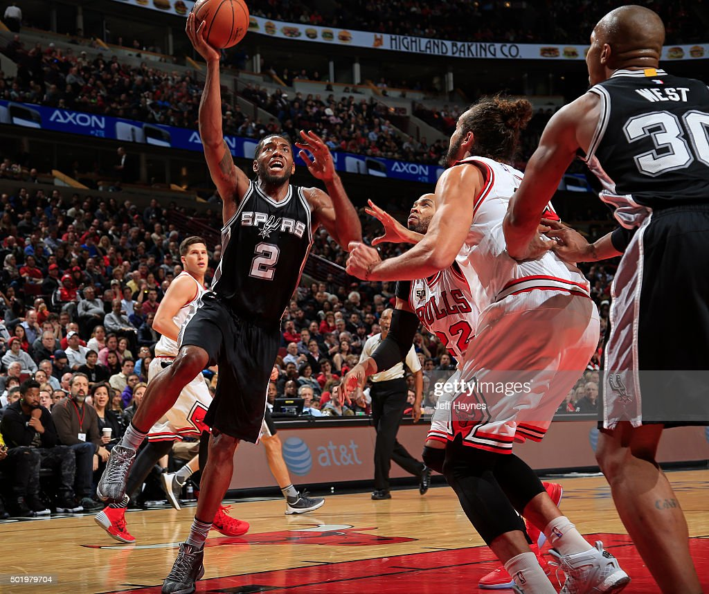 Kawhi Leonard #2 of the San Antonio Spurs goes for the layup during the game against the Chicago Bulls on November 30, 2015 at United Center in Chicago, Illinois.