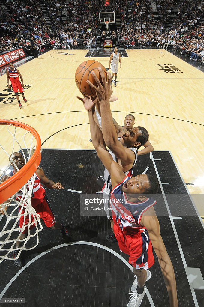 Kawhi Leonard #2 of the San Antonio Spurs goes to the basket against Jordan Crawford #15 of the Washington Wizards during the game between the Washington Wizards and the San Antonio Spurs on February 2, 2013 at the AT&T Center in San Antonio, Texas.