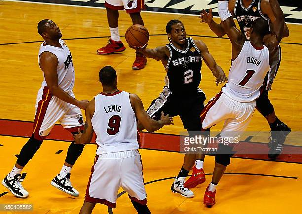 Kawhi Leonard of the San Antonio Spurs goes to the basket against Chris Bosh of the Miami Heat during Game Three of the 2014 NBA Finals at American...