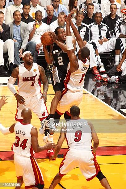 Kawhi Leonard of the San Antonio Spurs goes up for a shot against the Miami Heat during Game Four of the NBA Finals at the American Airlines Arena in...