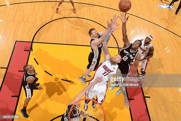 Kawhi Leonard of the San Antonio Spurs goes up for the ball against the Miami Heat during Game Six of the 2014 NBA Finals on June 12 2014 at American...