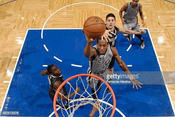 Kawhi Leonard of the San Antonio Spurs goes up for the dunk against the Orlando Magic during the game on November 29 2013 at Amway Center in Orlando...