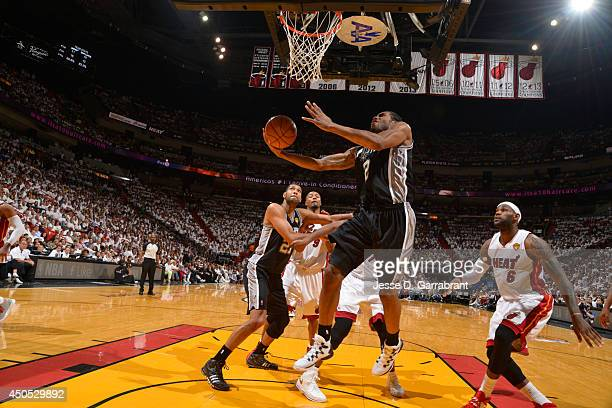 Kawhi Leonard of the San Antonio Spurs goes up for the reverse layup against the Miami Heat during Game Six of the 2014 NBA Finals on June 12 2014 at...