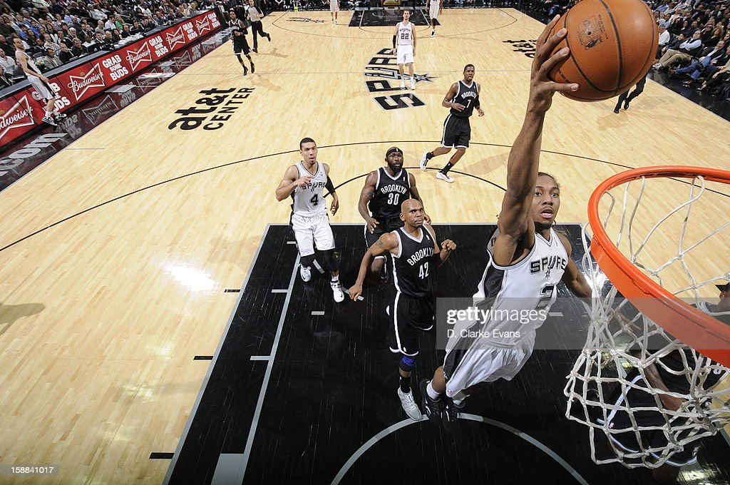 Kawhi Leonard #2 of the San Antonio Spurs goes up for the slam dunk against the Brooklyn Nets on December 31, 2012 at the AT&T Center in San Antonio, Texas.