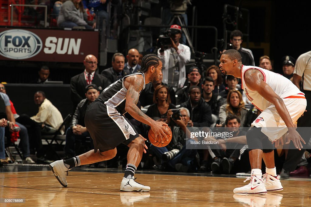 Kawhi Leonard #2 of the San Antonio Spurs handles the ball against Chris Bosh #1 of the Miami Heat on February 9, 2016 at American Airlines Arena in Miami, Florida.