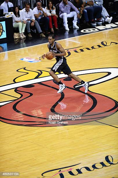 Kawhi Leonard of the San Antonio Spurs handles the ball against the Miami Heat during Game Four of the 2014 NBA Finals at American Airlines Arena on...