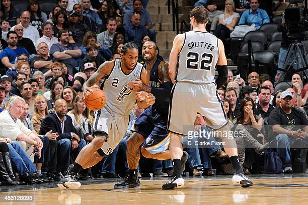 Kawhi Leonard of the San Antonio Spurs handles the ball against the Memphis Grizzlies at the ATT Center on April 6 2014 in San Antonio Texas NOTE TO...