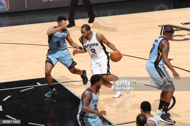 Kawhi Leonard of the San Antonio Spurs handles the ball against the Memphis Grizzlies during Game Two of the Western Conference Quarterfinals of the...