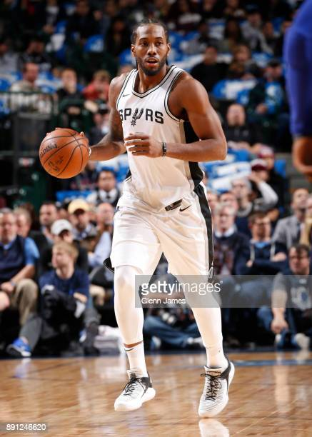 Kawhi Leonard of the San Antonio Spurs handles the ball against the Dallas Mavericks on December 12 2017 at the American Airlines Center in Dallas...