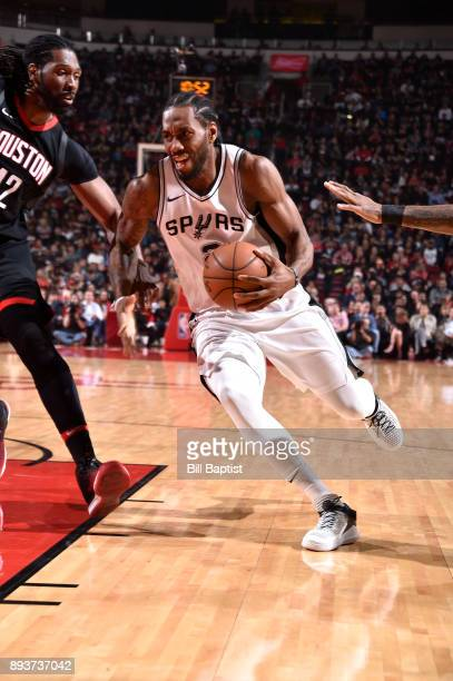 Kawhi Leonard of the San Antonio Spurs handles the ball against the Houston Rockets on December 15 2017 at the Toyota Center in Houston Texas NOTE TO...