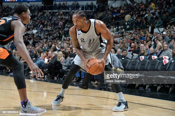 Kawhi Leonard of the San Antonio Spurs handles the ball against the Phoenix Suns on January 5 2018 at the ATT Center in San Antonio Texas NOTE TO...