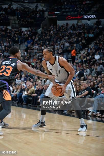 Kawhi Leonard of the San Antonio Spurs handles the ball against the Phoenix Suns on January 5 2018 at the ATT Center in San Antonio Texas NOTE TO...