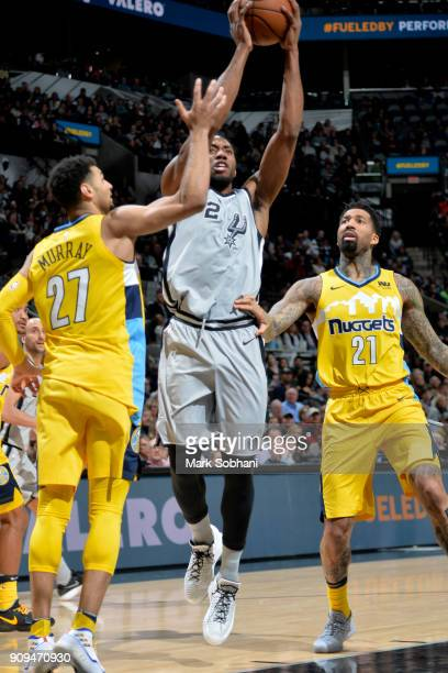 Kawhi Leonard of the San Antonio Spurs handles the ball against the Denver Nuggets on January 13 2018 at the ATT Center in San Antonio Texas NOTE TO...