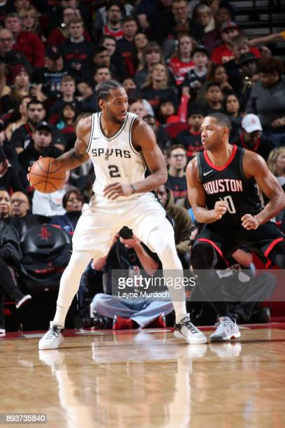 Kawhi Leonard of the San Antonio Spurs handles the ball during the game against the Houston Rockets on December 15 2017 at Toyota Center in Houston...