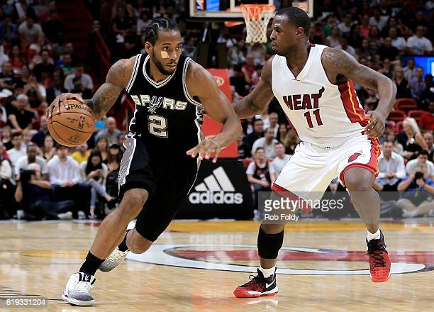 Kawhi Leonard of the San Antonio Spurs in action against Dion Waiters of the Miami Heat during the fourth quarter of the game at American Airlines...