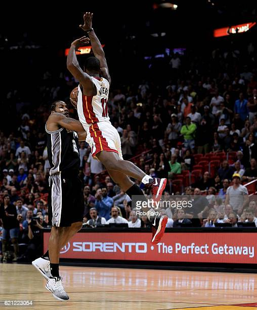 Kawhi Leonard of the San Antonio Spurs in action against Dion Waiters of the Miami Heat during the game at American Airlines Arena on October 30 2016...