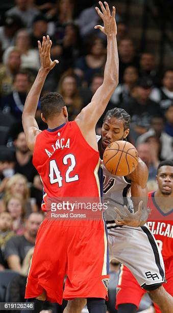 Kawhi Leonard of the San Antonio Spurs is fouled by Alexis Ajinca of the New Orleans Pelicans during game between New Orleans Pelicans and the San...