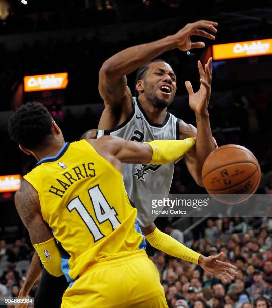 Kawhi Leonard of the San Antonio Spurs is fouled by Gary Harris of the Denver Nuggets at ATT Center on January 13 2018 in San Antonio Texas NOTE TO...
