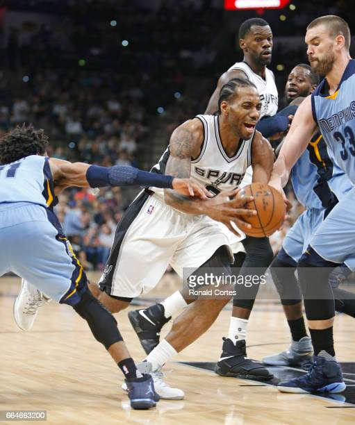 Kawhi Leonard of the San Antonio Spurs is fouled by Mike Conley of the Memphis Grizzlies as he drives to the basket at ATT Center on April 4 2017 in...