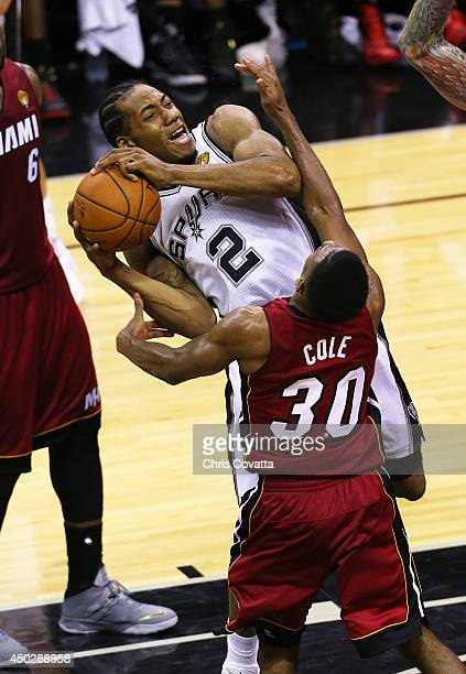 Kawhi Leonard of the San Antonio Spurs is fouled while shooting by Norris Cole of the Miami Heat in Game One of the 2014 NBA Finals at the ATT Center...