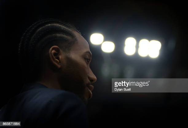 Kawhi Leonard of the San Antonio Spurs looks on during a timeout in the third quarter against the Chicago Bulls at the United Center on October 21...
