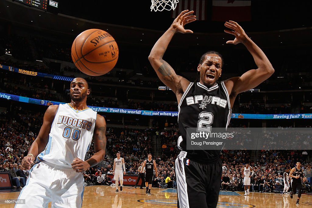 Kawhi Leonard #2 of the San Antonio Spurs looses control of the ball against Darrell Arthur #00 of the Denver Nuggets at Pepsi Center on December 14, 2014 in Denver, Colorado.