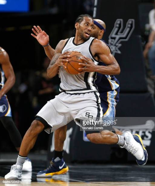 Kawhi Leonard of the San Antonio Spurs makes a pivot against Vince Carter of the Memphis Grizzlies in Game One of the Western Conference...