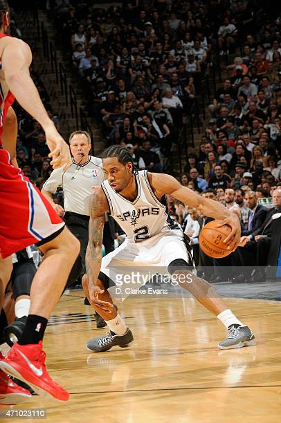 Kawhi Leonard of the San Antonio Spurs moves the ball against the Los Angeles Clippers during Game Three of the Western Conference Quarterfinals...