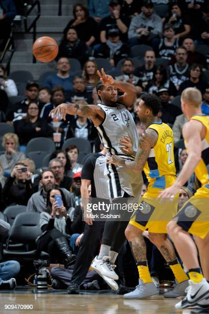 Kawhi Leonard of the San Antonio Spurs passes the ball against the Denver Nuggets on January 13 2018 at the ATT Center in San Antonio Texas NOTE TO...