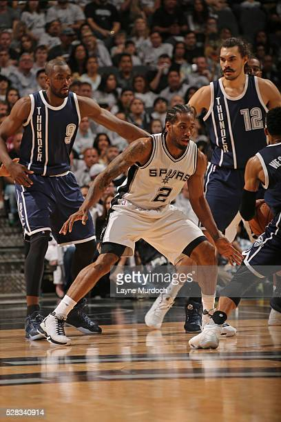 Kawhi Leonard of the San Antonio Spurs plays defense against the Oklahoma City Thunder in Game One of the Western Conference Semifinals during the...