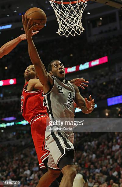 Kawhi Leonard of the San Antonio Spurs puts up a shot past Taj Gibson of the Chicago Bulls on his way to a game high 26 points at the United Center...