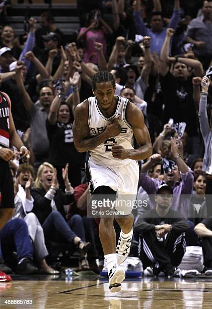 Kawhi Leonard of the San Antonio Spurs reacts after draining a three point shoot against the Portland Trail Blazers in Game Two of the Western...