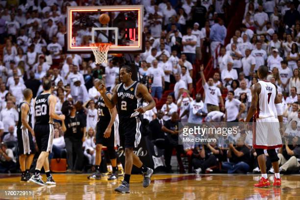 Kawhi Leonard of the San Antonio Spurs reacts after the Spurs defeat the Miami Heat 9288 in Game One of the 2013 NBA Finals at AmericanAirlines Arena...