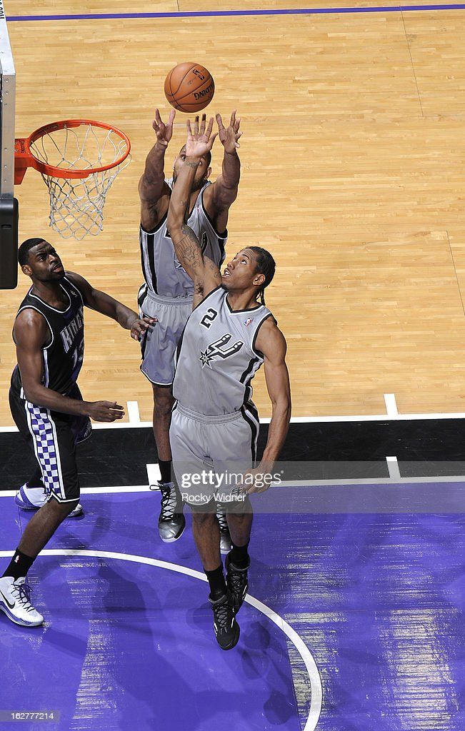 Kawhi Leonard #2 of the San Antonio Spurs rebounds against the Sacramento Kings on February 19, 2013 at Sleep Train Arena in Sacramento, California.