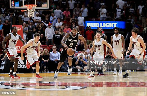 Kawhi Leonard of the San Antonio Spurs runs ahead of the Miami Heat during the fourth quarter of the game at American Airlines Arena on October 30...