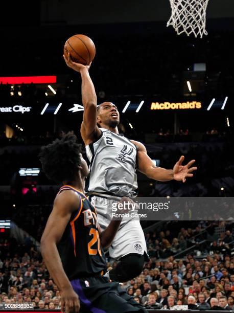 Kawhi Leonard of the San Antonio Spurs scores infant of Josh Jackson of the Phoenix Suns at ATT Center on January 05 2018 in San Antonio Texas NOTE...