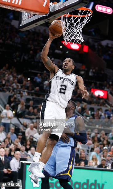 Kawhi Leonard of the San Antonio Spurs scores two after a breakaway against the Memphis Grizzlies at ATT Center on April 4 2017 in San Antonio Texas...