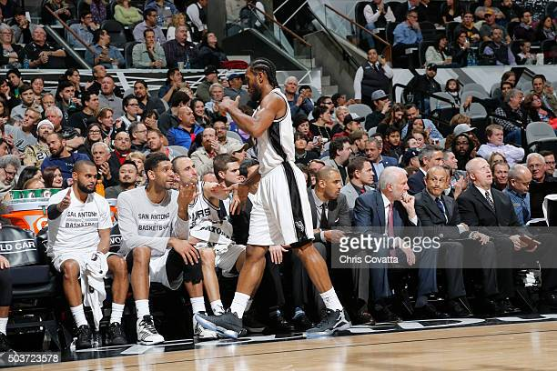 Kawhi Leonard of the San Antonio Spurs shakes hands with his teammates during the game against the Utah Jazz on January 6 2016 at the ATT Center in...