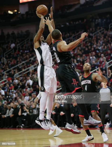 Kawhi Leonard of the San Antonio Spurs shoot over Eric Gordon of the Houston Rockets at Toyota Center on December 15 2017 in Houston Texas NOTE TO...