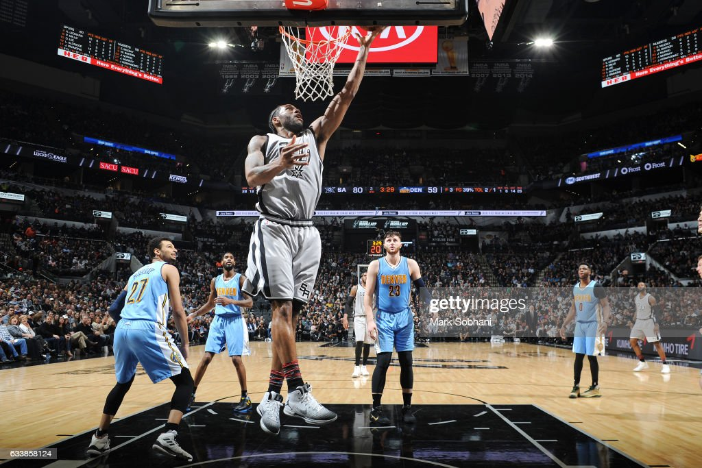 Kawhi Leonard #2 of the San Antonio Spurs shoots a lay up during the game against the Denver Nuggets on February 4, 2017 at the AT&T Center in San Antonio, Texas.